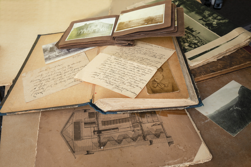Image of old postcards, letters and atlas